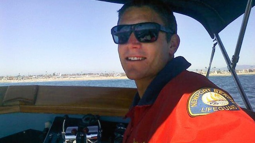 This undated photo provided by the Newport Beach Police Department shows Ben Carlson, 32, a Newport Beach lifeguard who drowned while trying to rescue a swimmer off the Southern California beach on Sunday, July 6, 2014.  (AP/Newport Beach Police Department)