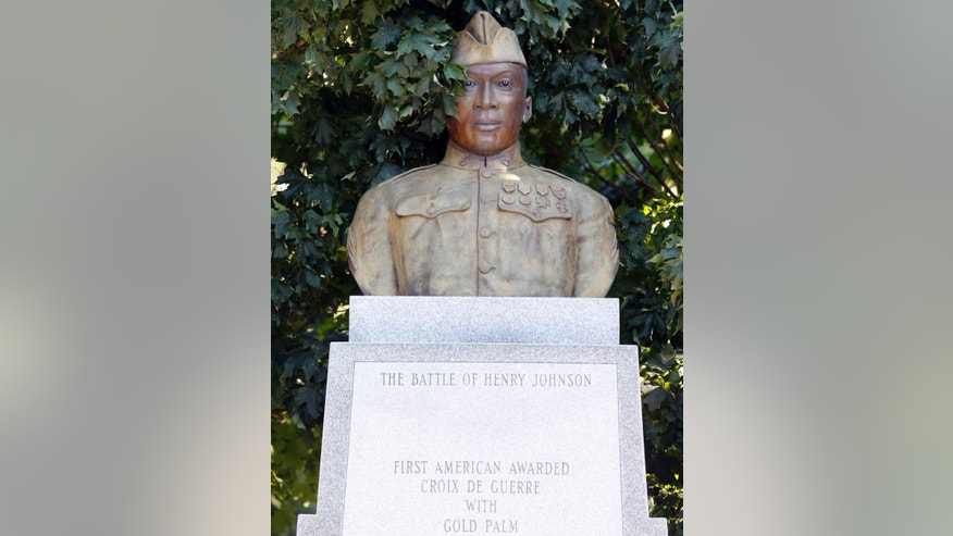 A statue of Henry Johnson is displayed in Washington Park on Thursday, July 10, 2014, in Albany, N.Y. U.S. Defense Secretary Chuck Hagel will consider whether the black World War I hero from Albany should be posthumously awarded the Medal of Honor nearly 100 years after he single-handedly fought off a German attack, killing several of the enemy and saving a comrade despite suffering serious wounds. Johnson was a solider in an all-black outfit, the 369th Infantry Regiment, a New York National Guard unit based in Manhattan and known as the Harlem Hellfighters. (AP Photo/Mike Groll)