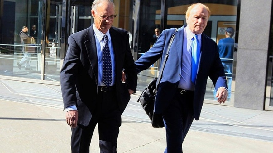 March 8, 2012: Robert Maegerle, left, walks out of a federal courthouse with attorney Jerome Froelich Jr. in San Francisco.