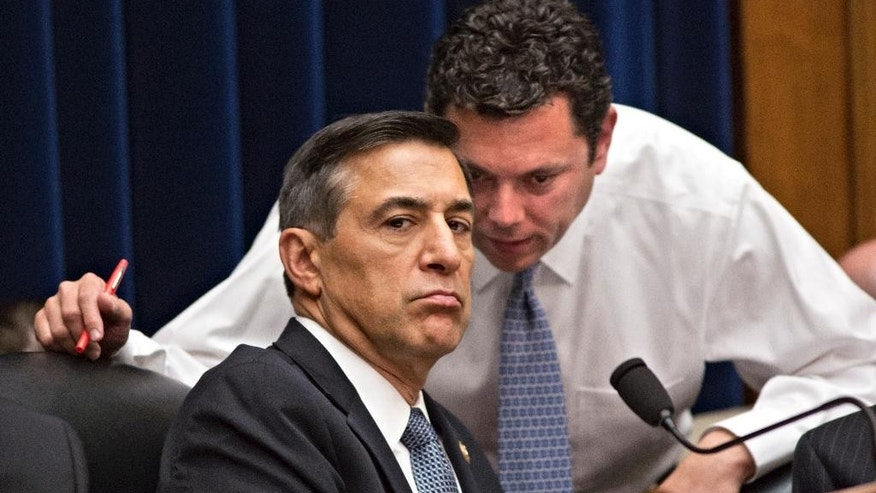 "FILE - This May 8, 2013, file photo shows House Oversight Committee Chairman Rep. Darrell Issa, R-Calif., left, confering with Rep. Jason Chaffetz, R-Utah, right, on Capitol Hill in Washington, during a House Oversight Committee hearing about the deadly assault on the U.S. diplomatic mission in Benghazi, Libya. The testimony of nine military officers severely undermines claims by Republican lawmakers that a ""stand-down order"" held back military assets who could have saved the U.S. ambassador and three other Americans killed during the assult. (AP Photo/J. Scott Applewhite, File)"