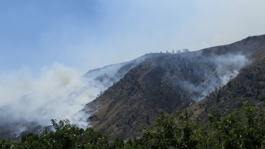 July 11, 2014: Smoke rises from the area of a wildfire near Entiat, Wash.