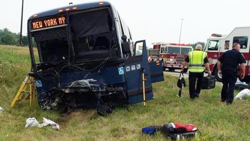 July 13, 2014: This Photo provided by the  Wayne County, Indiana Sheriffs Office, emergency personnel respond to the scene of a bus accident on interstate 70 near Richmond, Ind.  Authorities say a Greyhound bus and car collided on the highway near Indiana's border with Ohio, killing one person and injuring at least 18 others.