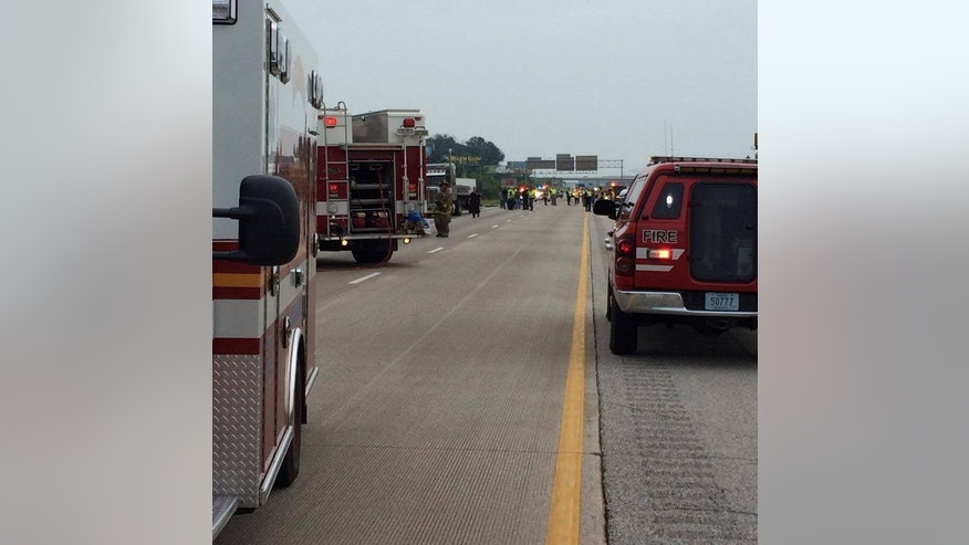 This Photo provided by the  Wayne County, Indiana Sheriff's Office, emergency personnel respond to the scene of a bus accident on Sunday, July 13, 2014 on interstate 70 near Richmond, Ind.  Authorities say a Greyhound bus and car collided on the highway near Indiana's border with Ohio, killing one person and injuring at least 18 others. (AP Photo/ Wayne County, Indiana Sheriff's Office)