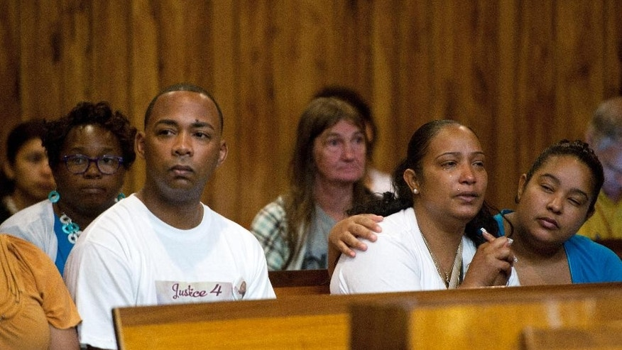 Alexis Rincon, front left, and Jenny Calderon, the parents of Genesis Rincon, sit in the courtroom during an appearance by Jeffery Ellerbee on Tuesday, July 15, 2014, in Paterson, N.J. Ellerbee, one of three men charged in the death of 12-year-old Genesis RIncon, who was killed by a stray bullet while riding a scooter in northern New Jersey, pleaded not guilty Tuesday to murder and weapons charges. (AP Photo/Northjersey.com, Tyson Trish, Pool)
