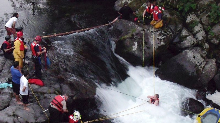 July 14, 2014: Skamania County sheriff's deputies and firefighters rescue John Napierkowski, bottom right, who was trapped in the water at Dougan Falls on the Washougal River in Washougal, Wash.