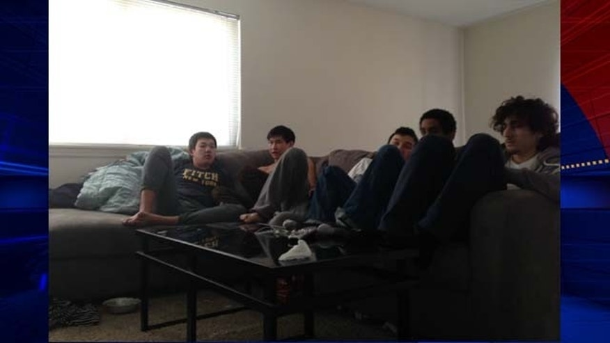 July 14, 2014: This image released by federal prosecutors shows Boston Marathon bombing suspect Dzhokhar Tsarnaev (far right) with friends in an apartment in New Bedford, Mass. in early 2013. (MyFoxBoston.com)