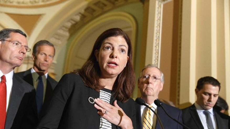 Sen. Kelly Ayotte, R-N.H., center, joined by Senate GOP leaders, talks to reporters about competing bills from the Democrats and Republicans on employee health coverage and birth control under the Affordable Care Act, a subject that the Supreme Court ruled on recently in the so-called Hobby Lobby case, Tuesday, July 15, 2014, during a news conference on Capitol Hill in Washington, Tuesday, July 15, 2014. From left are, Sen. John Barrasso, R-Wyo., Sen. John Thune, R-S.D., Ayotte and Senate Minority Leader Mitch McConnell of Ky.   (AP Photo/J. Scott Applewhite)