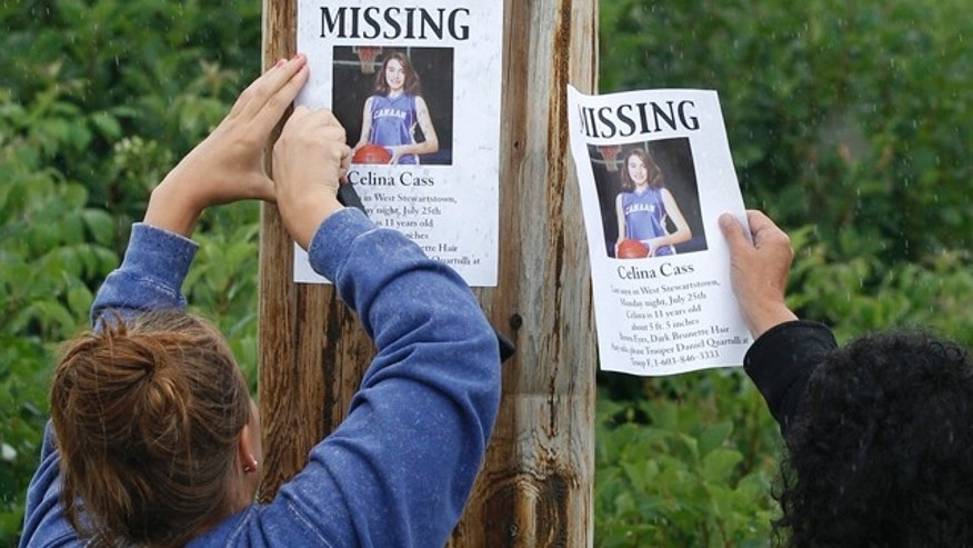 July 28: Residents of Stewartstown, N.H., post missing posters for Celina Cass in Colebrook, N.H.