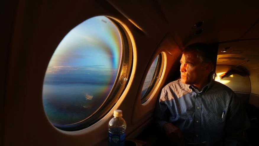As the sun sets, Washington Gov. Jay Inslee views smoke from the Chiwaukum Creek Fire near Leavenworth, Wash., from the window of his plane as he returns from a tour of areas affect by Washington state wildfires, Friday, July 18, 2014. (AP Photo/Ted S. Warren)