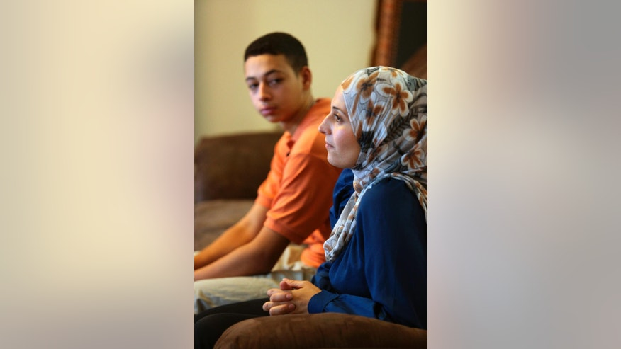 "Tariq Abu Khdeir, 15, left, sits with his mother Suha Khdeir during interview in their home, Sunday, July 20, 2014, in Tampa, Fla. Tariq Abu Khdeir flew home to Tampa last week and said in an interview Sunday that he hopes one day to visit loved ones anew and ""come back safe."" Israeli authorities released Tariq three days after he was detained and sentenced him to nine days of house arrest while they investigated what they said was his participation in violent protests over the death of his cousin, 16-year-old Mohammed Abu Khdeir. (AP Photo/Scott Iskowitz)"