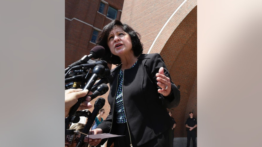 United States Attorney Carmen Ortiz, for the district of Massachusetts, speaks to members of the media outside federal court in Boston, Monday, July 21, 2014, after Azamat Tazhayakov was convicted of impeding the investigation into the Boston Marathon bombings. (AP Photo/Steven Senne)