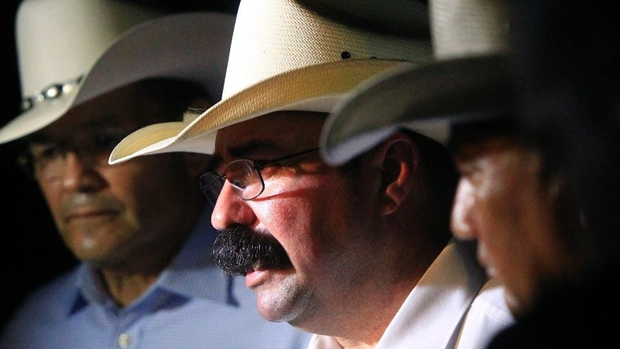 Hidalgo County Sheriff Eddie Guerra talks to the media after a standoff with a capitol murder suspect in La Joya, Texas on Tuesday, July 22, 2014. Officials said the suspect was later presumed dead after a final assault on the house. (AP Photo/The Monitor, Gabe Hernandez)  MAGS OUT; TV OUT