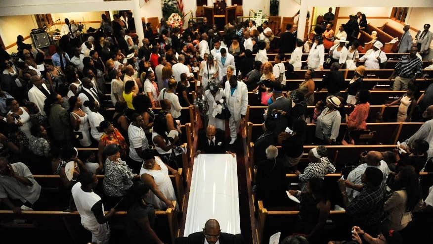 Funeral services are held for Eric Garner at Bethel Baptist Church in the Brooklyn borough of New York, Wednesday, July 23, 2014. An overflow crowd packed a church for the funeral of the man who died in police custody after an officer placed him in an apparent chokehold. (AP Photo/New York Daily News, Julia Xanthos, Pool)