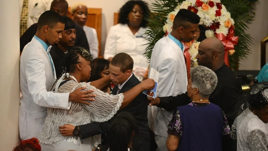 Gwen Carr hugs Ramsey Orta at the funeral for Carr's son Eric Garner, on Wednesday, July 23, 2014, in the Brooklyn borough of New York. Garner died in police custody after an officer placed him in an apparent chokehold. Orta shot video of the incident. (AP Photo/New York Daily News, Julia Xanthos, Pool)
