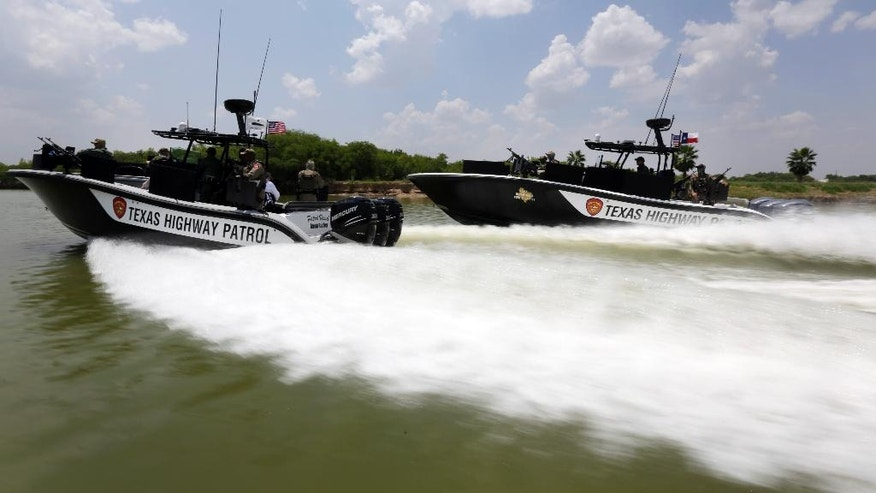 Texas Department of Safety Troopers patrol on the Rio Grand along the U.S.-Mexico border, Thursday, July 24, 2014, in Mission, Texas. Texas is spending $1.3 million a week for a bigger DPS presence along the border. (AP Photo/Eric Gay, Pool)