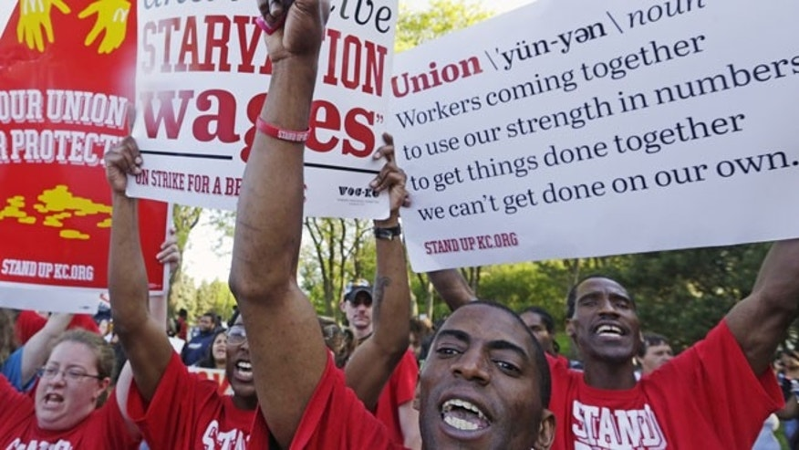 May 22, 2014: Protesters gather outside of the McDonald's Corporation headquarters in Oak Brook, Ill., during the annual shareholders meeting demonstrating for higher wages and the right to unionize.