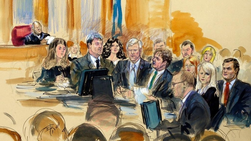 "In this courtroom sketch at the federal corruption trial of former Virginia Governor Robert F. McDonnell, center, and his wife, former first lady Maureen McDonnell, second from right, Judge James R. Spencer, left, presides during jury selection Monday, July 28, 2014, in Richmond, Va. Bob and Maureen McDonnell are charged in a 14-count indictment with accepting more than $165,000 in gifts and loans from the CEO of a dietary supplements company in exchange for helping promote his products. The defense team is gathered at a courtroom table and includes Victoria Taraktchian, John L. Brownlee, Robert McDonnell, Henry W. ""Hank"" Asbill, Marjorie Fargo, Maureen McDonnell, and William ""Bill"" Burck at left. Foreground figure, third from right, is Stephen Hauss.  (AP Photo/Dana Verkouteren)"