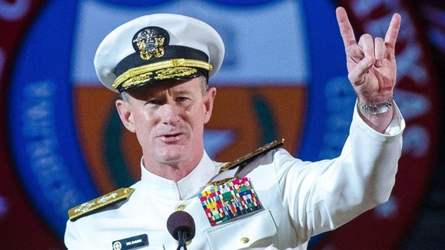 FILE - In this May 17, 2014 file photo Naval Adm. William H. McRaven, an alumnus, does the Longhorns' Hook 'em Horns hand signal during his commencement keynote address at the University of Texas in Austin. The University of Texas System regents on Tuesday, July 29, 2014, selected McRaven as the lone finalist for the job of chancellor, overseeing the systems 15 campuses and $14 billion budget. (AP Photo/ The University of Texas at Austin,  Marsha Miller, File)