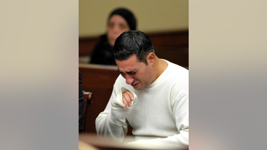 Defendant Bassel Saad sobs during a probable-cause hearing Wednesday afternoon, July 30, 2014, in Livonia, Mich. Saad is charged with second-degree murder in the death of soccer referee John Bieniewicz. (AP Photo/The Detroit News, Todd McInturf)
