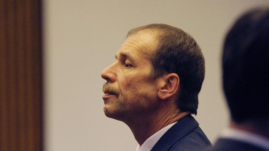 Theodore Wafer pauses at the end of Day 3 of his trial, Monday, July 28, 2014, Detroit, Mich. Wafer is the Dearborn Heights homeowner charged in the shooting death of Renisha McBride. (AP Photo/The Detroit News, Clarence Tabb Jr.)