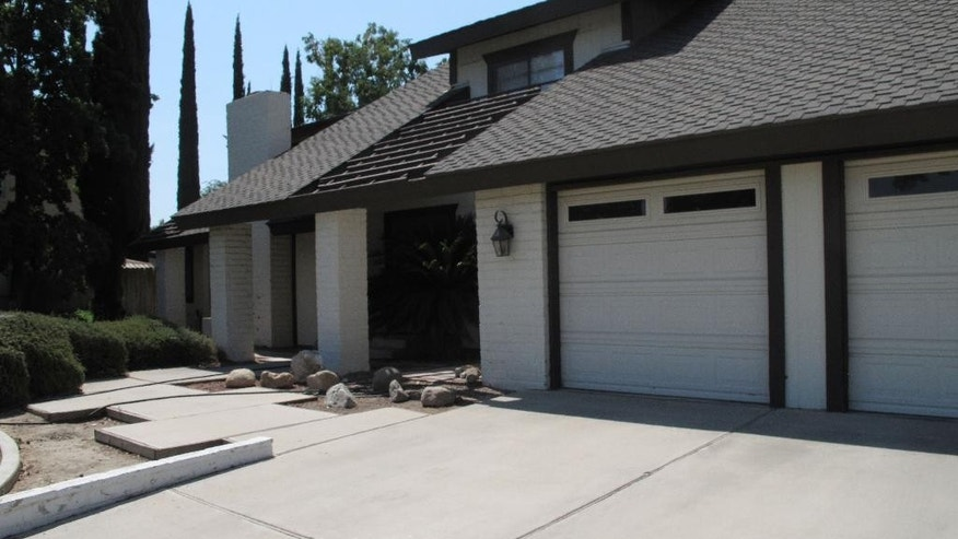 "This Friday, Aug. 1, 2014 photo shows the family home of Matthew Todd Miller in Bakersfield, Calif. Miller, 24, is one of the three Americans detained in North Korea and charged with ""anti-state"" crimes. (AP Photo/Scott Smith)"
