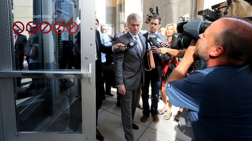 Former Virginia Gov. Bob McDonnell heads into the Federal Courthouse for his and his wife Maureen's corruption trial, in Richmond, Va., Thursday, July 31, 2014.  (AP Photo/Richmond Times-Dispatch, Bob Brown)