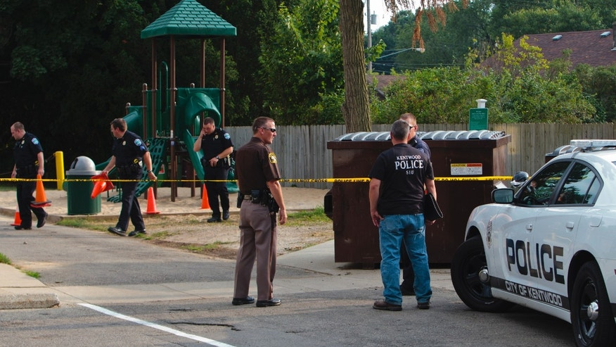 Aug. 4, 2014: Kentwood police investigate a stabbing that occurred in a playground in Pinebrook Village, in Kentwood, Mich. Police say a 12-year-old boy has stabbed a 9-year-old boy at the playground in western Michigan, sending the child to a hospital. Police also didn't immediately release detail on the condition of the wounded child. The older boy was taken into custody for questioning by police. (AP/The Grand Rapids Press, Joel Bissell)