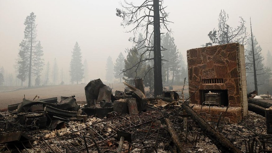 A structure burned down by the Eiler Fire is seen along the main road into town on Monday, Aug. 4, 2014, in Hat Creek, Calif. Firefighters were focusing on two wildfires near each other in Northern California that have burned through more than 100 square miles of terrain (AP Photo/Marcio Jose Sanchez)