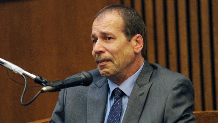 Theodore Wafer testifies in his own defense during the seventh day of testimony for the Nov. 2, 2013, killing of Renisha McBride, Monday, Aug. 4, 2014, in Detroit. He said he feared for his life when he fired at McBride on his porch in Dearborn Heights, Mich. Wafer is charged with second-degree murder and could be sentenced to up to life in prison with the chance for parole, if he's convicted. (AP Photo/Detroit News, Clarence Tabb Jr.)