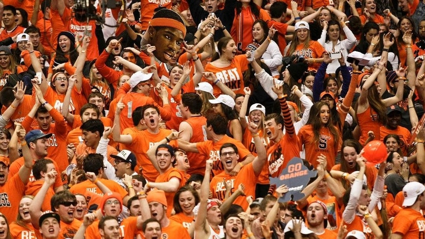 FILE - In this Feb. 1, 2014 file photo, Syracuse fans celebrate after the team defeated Duke in an NCAA college basketball game in Syracuse, N.Y.  The Princeton Review's annual rankings of campus life issue, released Monday, Aug. 4, 2014, put the Orange at No. 1 on the list of the nation's top party schools. (AP Photo/Nick Lisi, File)