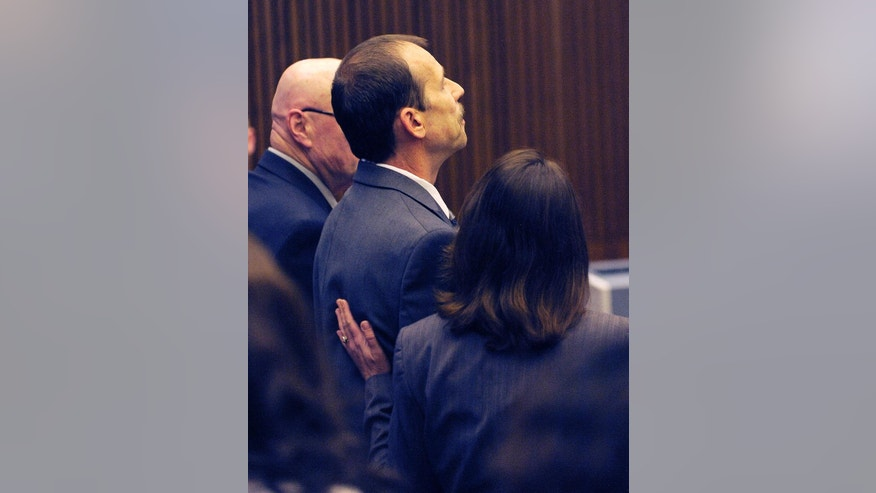 Theodore Wafer stares straight ahead after being convicted of second-degree murder and manslaughter as his attorney Cheryl Carpenter comforts him Thursday, Aug. 7, 2014 in Detroit.  Wafer, 55, shot Renisha McBride through a screen door on Nov. 2, hours after she crashed into a parked car a half-mile from his house. The jury convicted Wafer of second-degree murder and manslaughter after deliberating for about eight hours over two days.  (AP Photo/The Detroit News, Clarence Tabb Jr.)