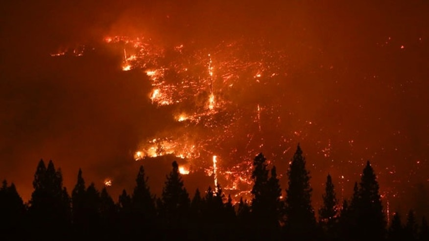 Aug. 24, 2013: A forest smolders as the Rim Fire continues to burn near Yosemite National Park, Calif. Keith Matthew Emerald was charged Thursday, Aug. 7, 2014 with starting the state's third-largest wildfire.