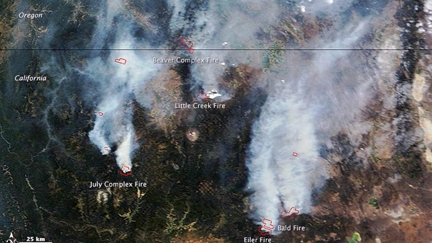 This Aug. 2, 2014 satellite image provided by NASA shows a view from space of several fires burning in northern California and southern Oregon. The Moderate Resolution Imaging Spectroradiometer (MODIS) on NASA's Terra satellite captured the image. Red outlines show where high surface temperatures are associated with active burning. Authorities said Friday, Aug. 8, 2014, the wildfire burning in Oregon's wind-swept Columbia River Gorge has destroyed a home, damaged two others and is threatening 740 more. All graphic material is in the original image from the source. The horizontal line in the upper third of the photo is the Oregon-California border. (AP Photo/NASA)