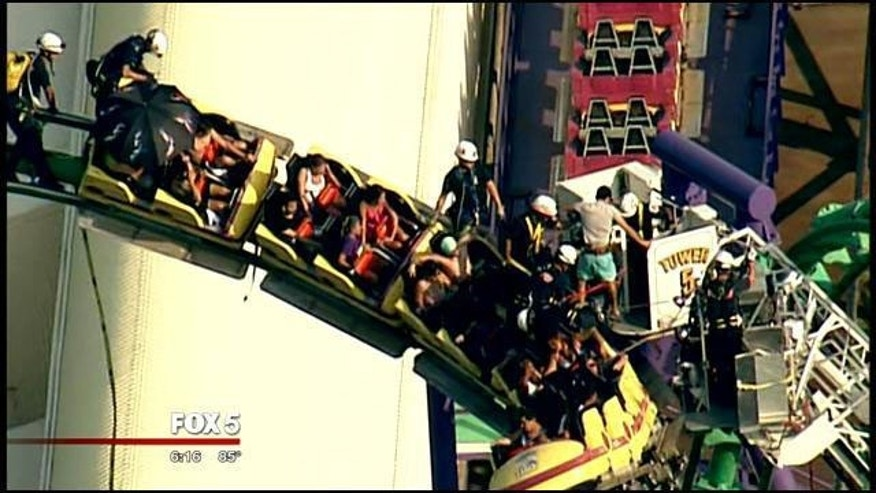 August 10, 2014: Rescuers work to remove patrons from a stuck roller coaster at Six Flags America in Upper Marlboro, Md. (MyFoxDC.com)