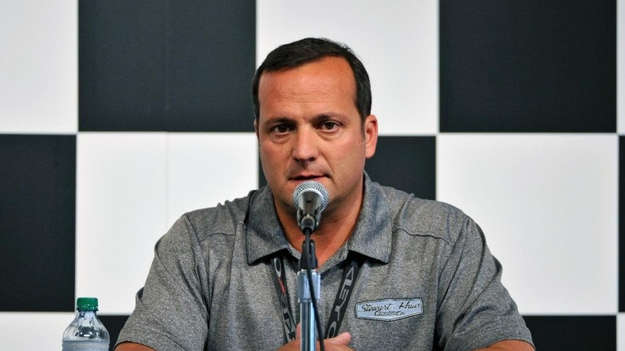 Greg Zipadelli, competition director of Stewart-Haas Racing, addresses members of the media before a NASCAR Sprint Cup Series auto race at Watkins Glen International, Sunday, Aug. 10, 2014, in Watkins Glen N.Y. Zipadelli said Tony Stewart would not drive Sunday after he struck and killed a sprint car driver who had climbed from his car and was on the track trying to confront Stewart during a race in upstate New York on Saturday night. (AP Photo/Derik Hamilton)