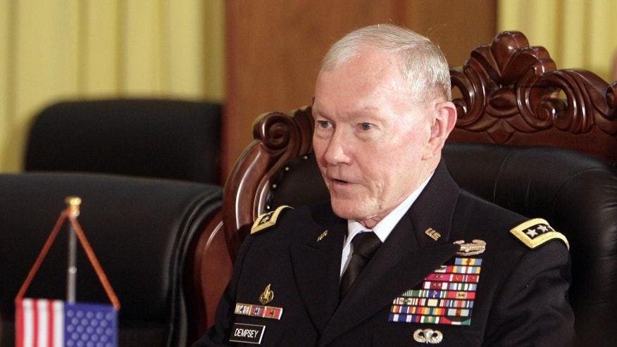 U.S. Chairman of the Joint Chiefs of Staff, Gen. Martin Dempsey speaks during a meeting with Vietnamese Chief of General Staff of the Army, Lt. Gen. Do Ba Ty in Hanoi, Vietnam on Thursday Aug. 14, 2014. (AP Photo/Tran Van Minh)