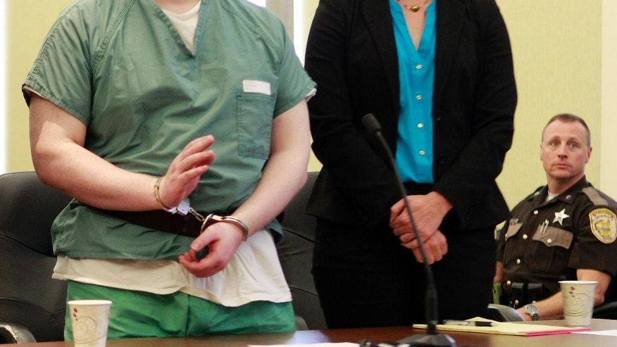 "Convicted Killer Seth Mazzaglia raises his hand to take the oath with his lawyer Melissa Davis in Strafford County Superior Court in Dover, N.H. Tuesday, Aug. 12, 2014. Mazzaglia, who was convicted of raping and killing a University of New Hampshire student and said he didn't want to listen to the victim's family ""yell and whine"" at his sentencing hearing about what a monster he is, has dropped his bid to skip the hearing. Lawyers for Mazzaglia withdrew their motion contending that he had a right to skip Thursday's sentencing. (AP Photo/Jim Cole)"
