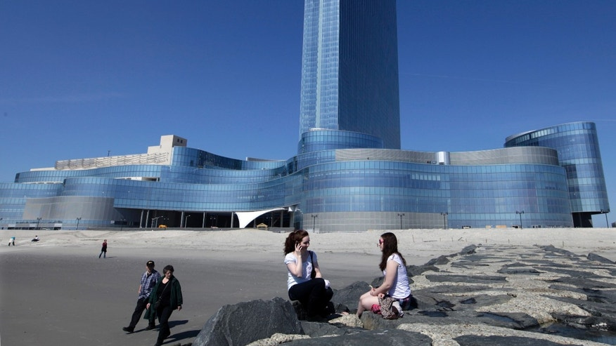 March 19, 2012: Kati MacFarline, left, of Nashua, N.H., and Christine Kashian, of Caribou, Maine, sit on a jetty near Revel in Atlantic City, N.J. (AP/Mel Evans, File)