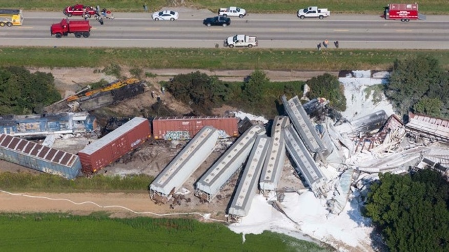 August 17, 2014: Emergency personnel work at the site of a head-on collision of two Union Pacific trains outside of Hoxie, Ark. Arkansas State Police said two Union Pacific train crew members were killed and two others injured in the early morning accident. (AP Photo/Arkansas Democrat-Gazette, Melissa Sue Gerrits)