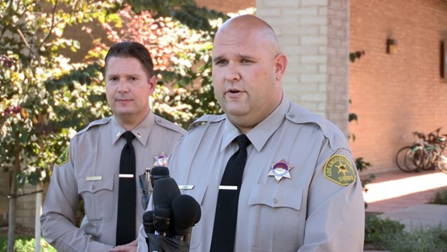 August 17, 2014: Santa Clarita Valley Sheriffs Station deputy Joshua Dubin announces the arrest of a 15-year-old boy on suspicion of posting online threats to shoot students at schools in Valencia, Calif. (AP Photo/The Santa Clarita Valley Signal, Austin Dave)