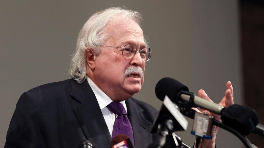 Former New York City chief medical examiner Dr. Michael Baden speaks during a news conference to share preliminary results of a second autopsy done on Michael Brown Monday, Aug. 18, 2014, in St. Louis County, Mo. The independent autopsy shows 18-year-old Michael Brown was shot at least six times. (AP Photo/Jeff Roberson)