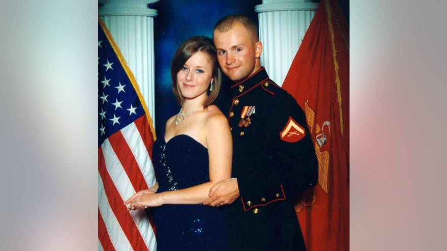 FILE - This undated file photo provided by the San Bernardino County, Calif., Sheriff's Department shows Erin Corwin, left, with her husband, Jonathan Wayne Corwin, a corporal in the U.S. Marine Corps. Erin Corwin disappeared after leaving her home on the Twentynine Palms Marine Corps base June 28, 2014. Christopher Brandon Lee, a recently discharged Marine who volunteered at a horse ranch with Erin Corwin, was arrested July 4, 2014, on suspicion of possession of a destructive device. Lee, the alleged lover of Erin Corwin, was arrested Sunday, Aug. 18, 2014, in Alaska in connection with Corwin's disappearance, the sheriff's department announced Monday, Aug. 8, 2014. (AP Photo/San Bernardino County Sheriff's Department, File)