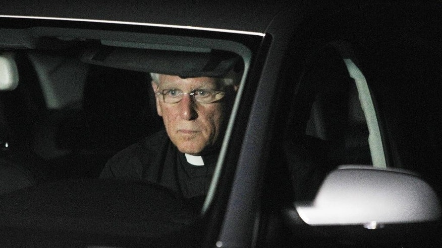 Rev. Paul Gousse from Our Lady of the Holy Rosary leaves after meeting with the family of American freelance journalist James Foley in Rochester, N.H., Tuesday Aug. 19, 2014. The White House said Tuesday it has not confirmed the authenticity of a video that purports to show the killing of  Foley who went missing in Syria nearly two years ago. (AP Photo/Jim Cole)