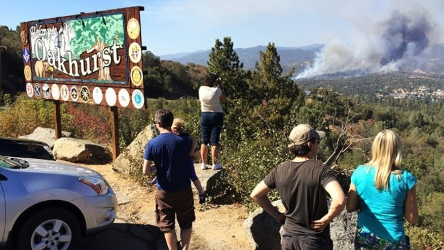 August 18, 2014: People watch a fire burning from the Highway 41 overlook on the way north into Oakhurst, Calif. The fire is burning north of the community. (AP Photo/The Fresno Bee, Eric Paul Zamora)