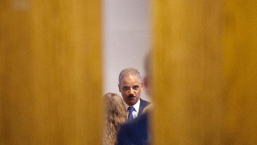 Attorney General Eric Holder participates in closed door meeting with students at St. Louis Community College Florissant Valley, Wednesday, Aug. 20, 2014 in Ferguson, Mo. Holder arrived in Missouri on Wednesday, a small group of protesters gathered outside the building where a grand jury could begin hearing evidence to determine whether a Ferguson police officer who shot 18-year-old Michael Brown should be charged in his death.   (AP Photo/Pablo Martinez Monsivais, Pool)