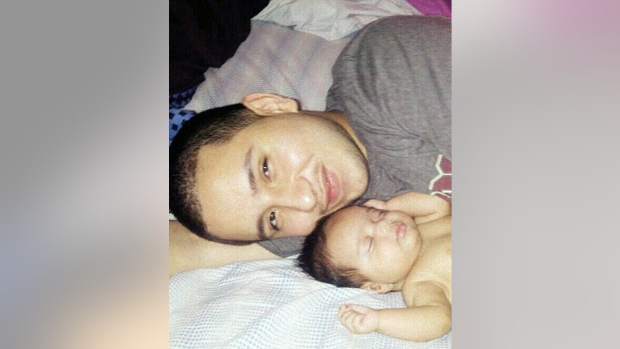 This undated photo provided by Felicia Leija shows Jose Banda, 20, with his newborn daughter Alisa. Authorities say Banda was fatally shot in December 2012 minutes after he slammed into a truck that was being pushed by a father and his two sons after the vehicle had broken down. The two boys were killed in the alcohol-related accident. Investigators allege the boys' father, David Barajas, shot Banda. Barajas' trial is set to begin Monday, Aug. 18.  (AP Photo/Felicia Leija)