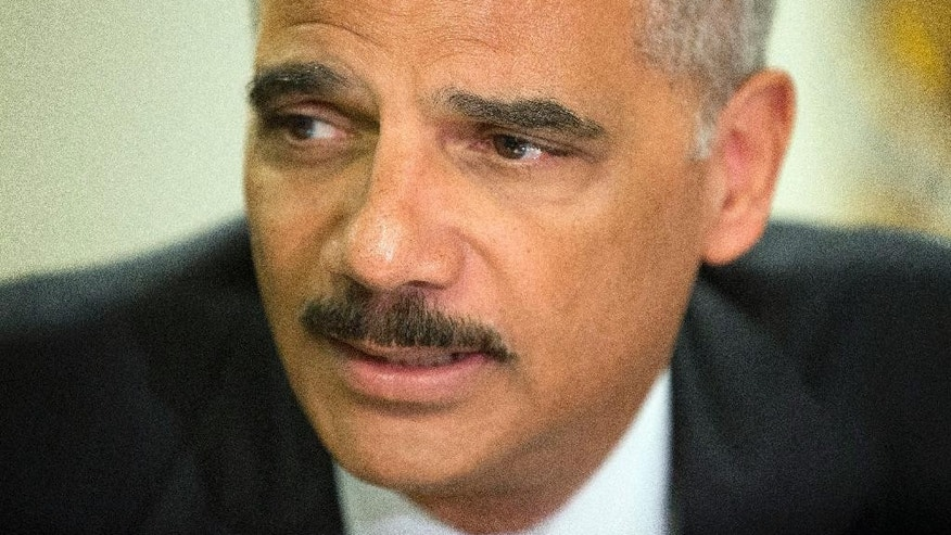 "Attorney General Eric Holder during his meeting at the FBI building in St. Louis, Wednesday, Aug. 20, 2014.  Holder has told Ferguson community leaders that he has assigned the federal government's ""most experienced agents and prosecutors"" to the investigation of a white police officer's fatal shooting of a black 18-year-old.  (AP Photo/Pablo Martinez Monsivais, Pool)"