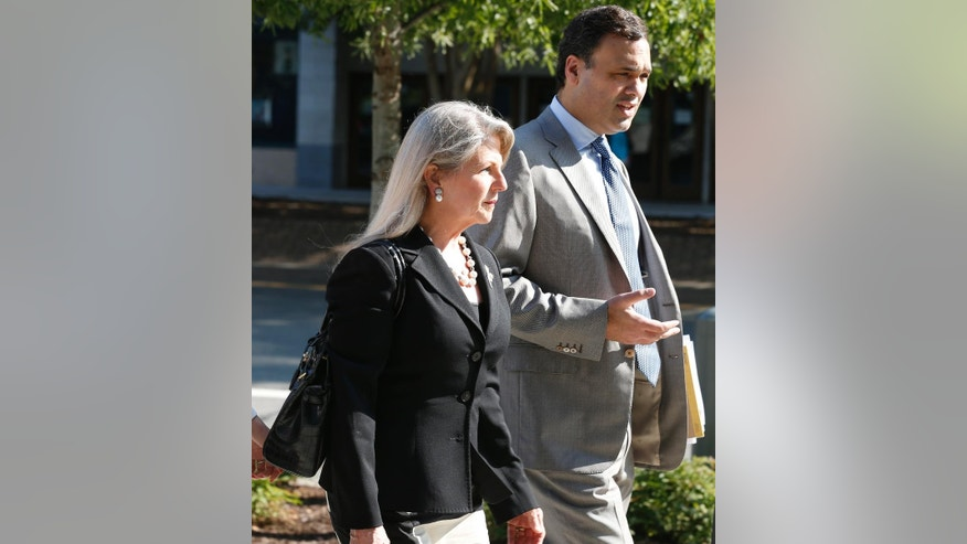 Former Virginia first lady Maureen McDonnell arrives at federal court with her attorney William Burck in Richmond, Va., Thursday, Aug. 21, 2014. Former Gov. Bob McDonnell took the stand in his own defense on Wednesday and is expected to continue Thursday. (AP Photo/Steve Helber)