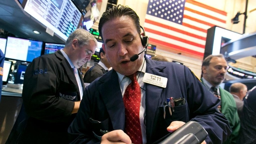 Trader Tommy Kalikas, center, works on the floor of the New York Stock Exchange Thursday, Aug. 21, 2014. U.S. stocks are opening higher, pushing the Standard & Poor's 500 index closer toward another record high. (AP Photo/Richard Drew)