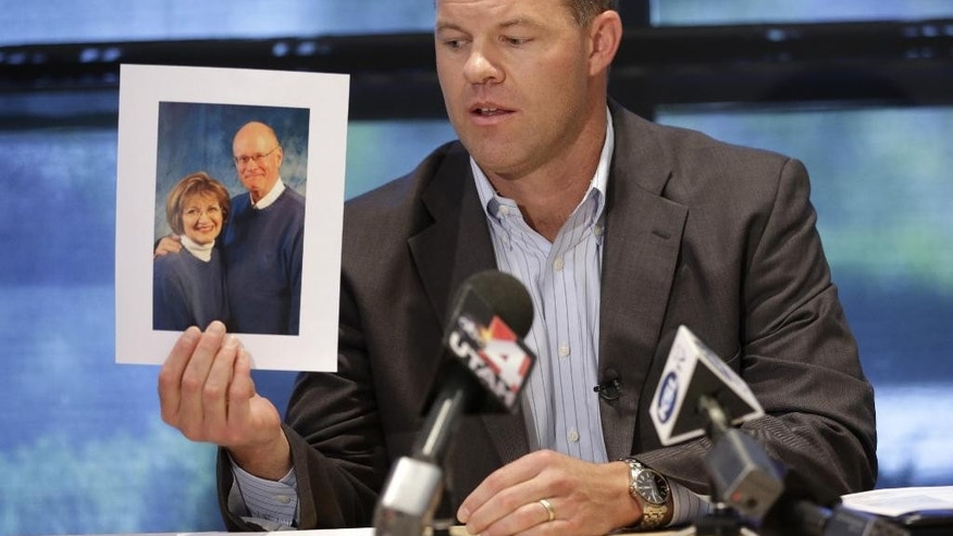 Attorney Paxton Guymon holds a photograph of Jim and Jan Harding during a news conference in Salt Lake City on Thursday, Aug. 14, 2014. Jan Harding, 67, remains hospitalized but was upgraded from critical to serious condition this week. She drank sweet tea containing a toxic cleaning chemical, severely burning her mouth and throat at a Utah restaurant after an employee mistook the substance for sugar and mixed it into a dispenser, Guymon said. (AP Photo/Rick Bowmer)